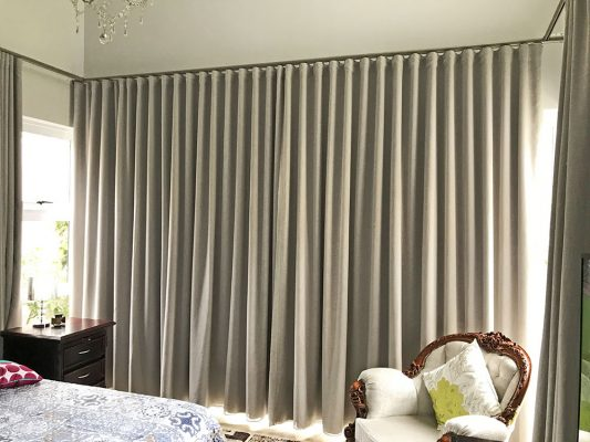Wave track rail with wave pleat taped curtains