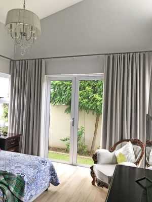 Wave track rail with, wave pleat taped curtains